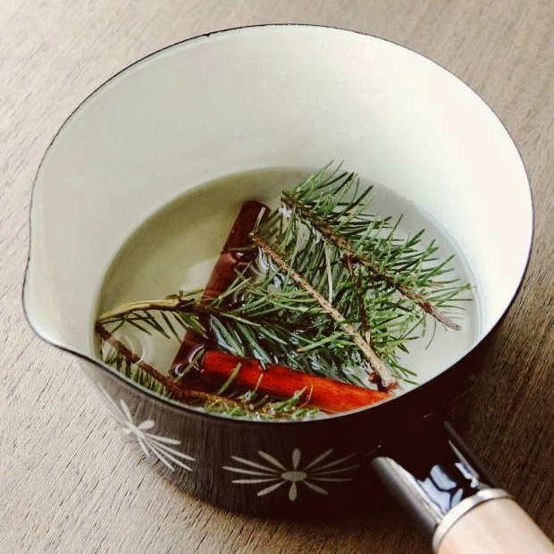 Use a simmer pot of pine branches to fill your home with the scent of a Christmas tree
